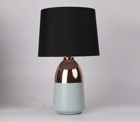 Desk lamp with black lampshade, and ceramic base with rose gold colour and sage green