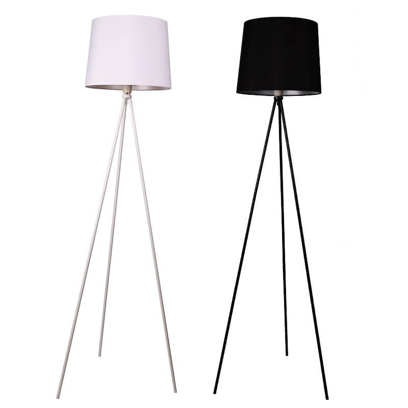 Two metal floor lamps in white and black with shade and base from the Haunui International collection