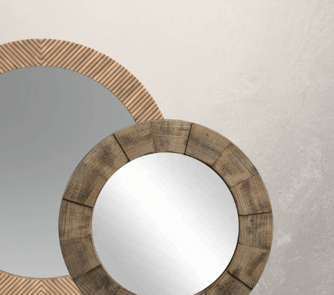 Two round wall mirrors with wooden frames