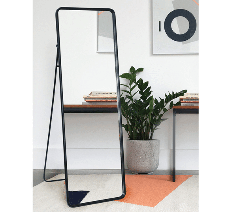 Full length mirror with stand in a bedroom